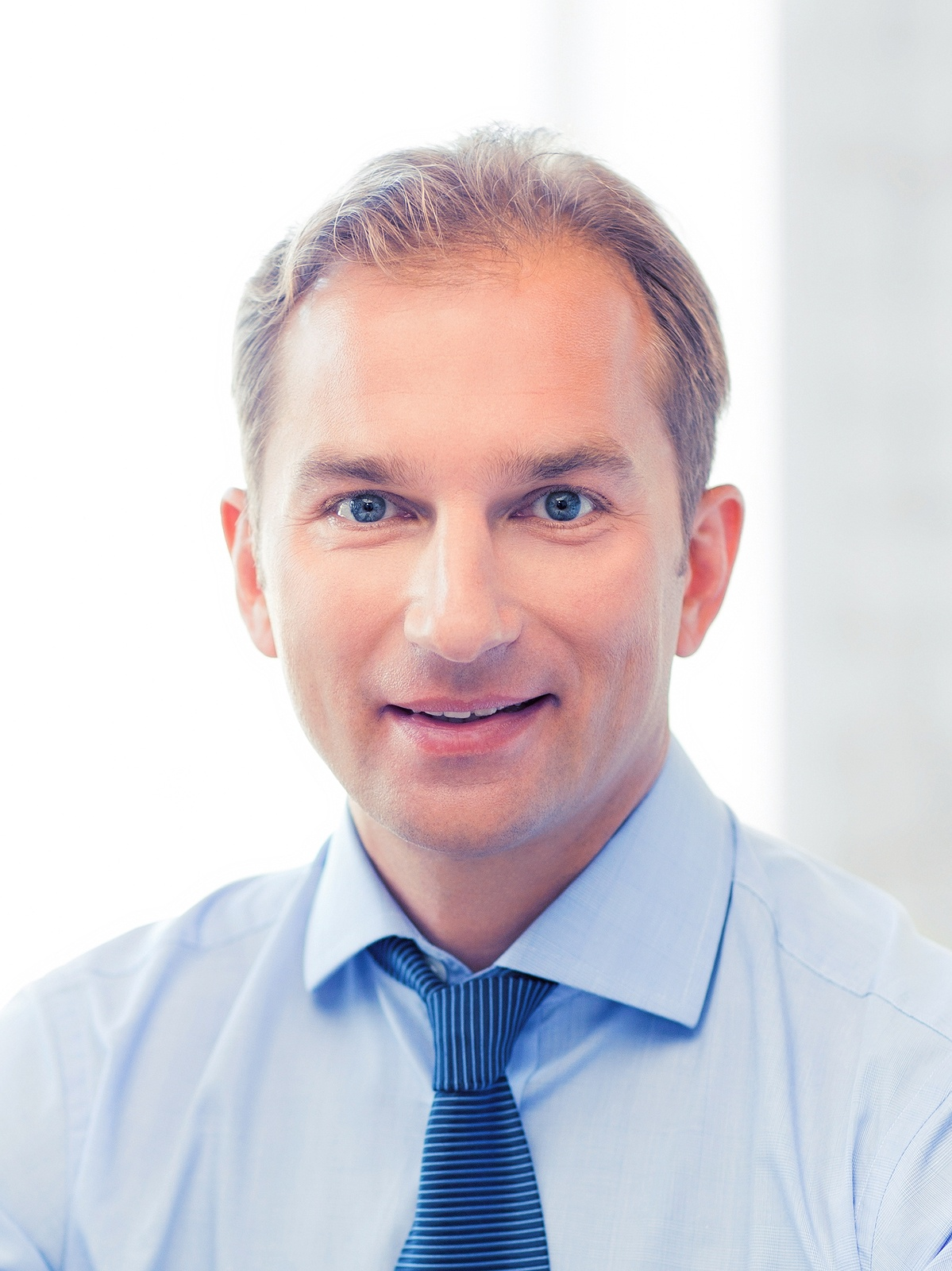 bigstock-smiling-middle-aged-businessma-138509663.jpg
